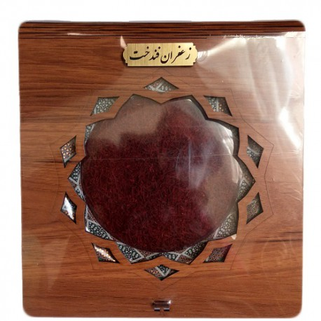 هفت مثقال زعفران فندخت در بسته بندی شکیل با ظرف خاتم و حفاظ چوبی مطابق عکس (32.2 کرم زعفران سرگل)